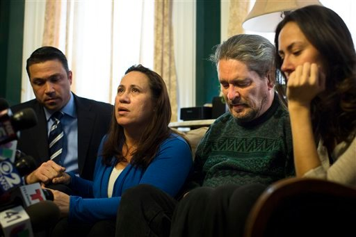 Betzaida Jimenez, mother of 33-year-old Sarai Sierra who was found dead on Saturday in Turkey, speaks to the media at a friend's home in Staten Island alongside Congressman Michael Grimm, left, her husband Dennis Jimenez, and a family friend (AP)