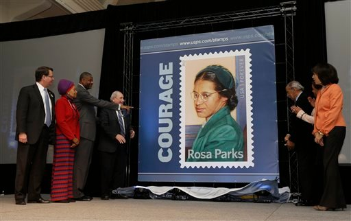 Officials help unveil the Rosa Parks' 100th birthday commemorative postage stamp at The Henry Ford in Dearborn, Mich., Monday, Feb. 4, 2013, on what would have been the late civil rights icon's 100th birthday. (AP Photo/Carlos Osorio)