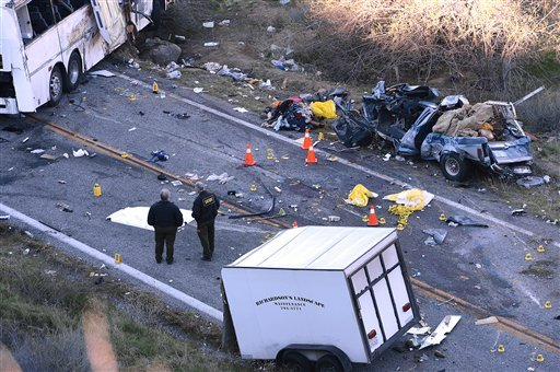© Authorities work Monday Feb. 4, 2013, at the scene of Sunday's fatal tour bus crash on Highway 38 north of Yucaipa, Calif., that left at least seven people dead and dozens injured.