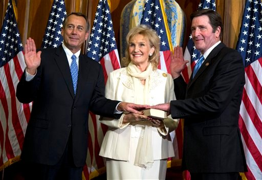 © In this Jan. 3, 2013, file photo, House Speaker John Boehner of Ohio performs a mock swearing in for Rep. John Garamendi, D-Calif., on Capitol Hill in Washington as the 113th Congress began.