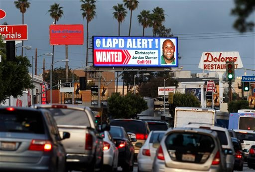  A digital billboard along Santa Monica Boulevard on the west side of Los Angeles shows a &quot;wanted&quot; alert for former Los Angeles police officer Christopher Dorner Friday, Feb. 8, 2013.