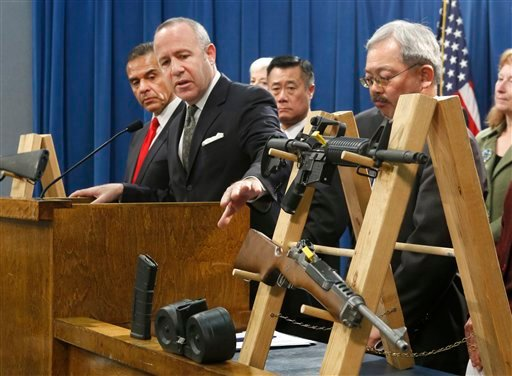 Senate President Pro Tem Darrell Steinberg, second from left, glances to a pair of semi-automatic rifles as he discusses a package of proposed gun control legislation at a Capitol news conference in Sacramento, Calif., Thursday, Feb. 7, 2013. (AP)