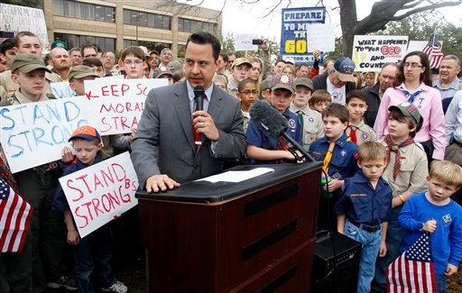 Surrounded by area scouts, Jonathan Saenz, president of Texas Values, reads the press release to that crowd announcing that the Boy Scouts of America will be postponing its decision to admit gays. (AP)