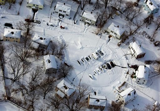  A Southwest Connecticut neighborhood is buried in snow Sunday, Feb. 10, 2013, in the aftermath of a storm that hit Connecticut and much of the New England states. (AP Photo/Craig Ruttle)