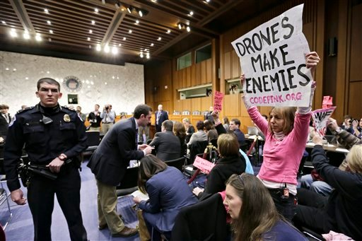 © CODEPINK co-founder Medea Benjamin, right and other CODEPINK protestors, a group opposed to U.S. militarism, disrupt the start of the Senate Intelligence Committee confirmation hearing for John Brennan, Thursday, Feb. 7, 2013, on Capitol Hill.