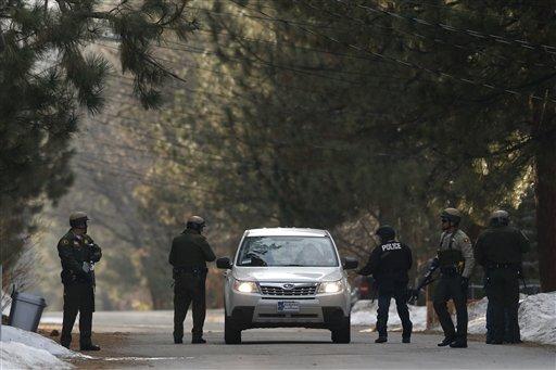 © San Bernardino County sheriff's deputies search a car in Big Bear, Calif, Thursday, Feb. 7, 2013.