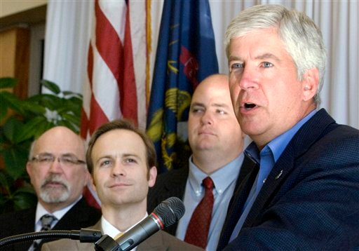 FILE - In this Feb. 6, 2013 file photo Michigan Republican Gov. Rick Snyder announces an expansion of the state's Medicaid health care program in Lansing, Mich. (AP)