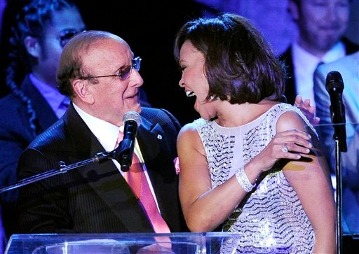 FILE - This Feb. 13, 2011 file photo shows music producer Clive Davis with singer Whitney Houston at the pre-Grammy gala &amp; salute to industry icons with Clive Davis honoring David Geffen in Beverly Hills, Calif. (AP)
