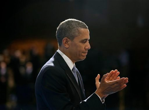 © President Barack Obama applauds after introducing outgoing Defense Secretary Leon Panetta during a Farewell Tribute for Panetta, Friday, Feb. 8, 2013, at Joint Base Myer-Henderson Hall in Arlington, Va. (AP Photo/Pablo Martinez Monsivais)
