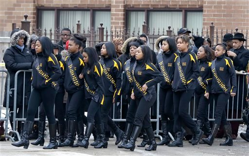© Members of the Crystal Elegance Majorettes arrive at the Greater Harvest Missionary Baptist Church for the funeral service of Hadiya Pendleton, also a member of the majorette team, Saturday, Feb. 9, 2013, in Chicago.