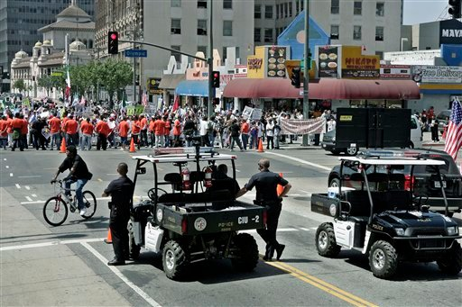 "©  In this Thursday, May 1, 2008 file photo, Los Angeles Police Officers stand near ""Phraselators"" as they monitor May Day protesters gathering downtown to call for immigration reform in Los Angeles."