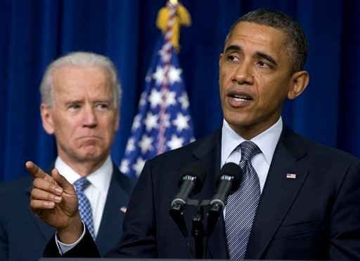 © In this Jan. 16, 2013 file photo, President Barack Obama, accompanied by Vice President Joe Biden, talks about proposals to reduce gun violence, in the South Court Auditorium at the White House in Washington.