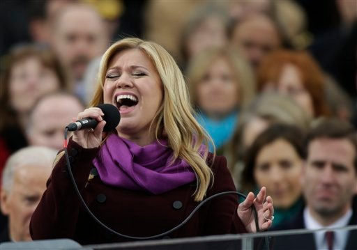 © In this Jan. 21, 2013, file photo, singer Kelly Clarkson performs at the ceremonial swearing-in for President Barack Obama at the U.S. Capitol in Washington.