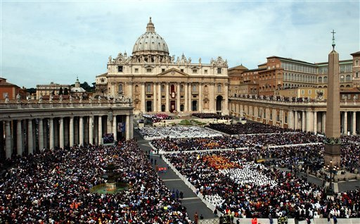 © his April 24, 2005 file photo shows thousands of people attending the installment Mass of Pope Benedict XVI in St. Peter's Square, at the Vatican.