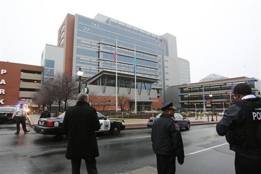 Police stand outside the New Castle County Courthouse, Monday morning, Feb. 11, 2013 in Wilmington, Del. after a man killed his estranged wife and two others. (AP Photo/The News Journal/William Bretzger)