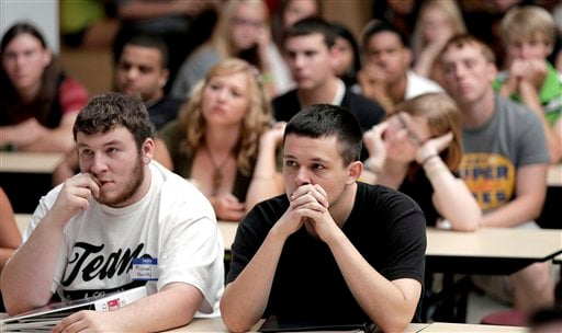 © In this Wednesday, Aug. 17, 2011 file photo, students listen during an assembly on the first day of school at a temporary high school in a converted store in Joplin, Mo., nearly three months after an EF-5 tornado destroyed six schools.