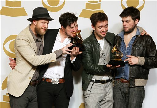 "© Members of the musical group Mumford & Sons, from left, Ted Dwane, Marcus Mumford, Ben Lovett and Winston Marshall, pose backstage with the best long form music video award for ""Big Easy Express"" and the album of the year award for ""Babel."""