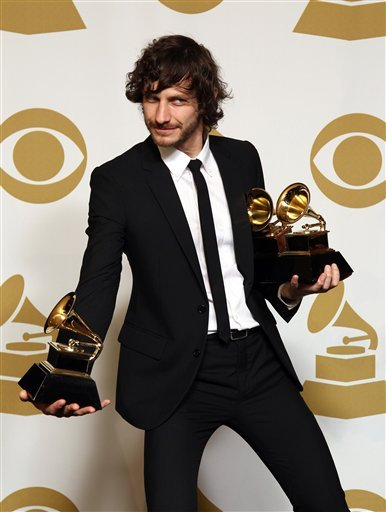 "© Gotye poses backstage with the awards for best pop duo/group performance of the year and record of the year for ""Somebody That I Used to Know"" at the 55th annual Grammy Awards on Sunday, Feb. 10, 2013, in Los Angeles."