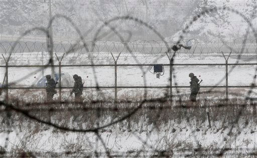 South Korean army soldiers patrol along barbed-wire fences at the Imjingak Pavilion, near the demilitarized zone of Panmunjom, in Paju, South Korea, Tuesday, Feb. 12, 2013. (AP Photo/Ahn Young-joon)