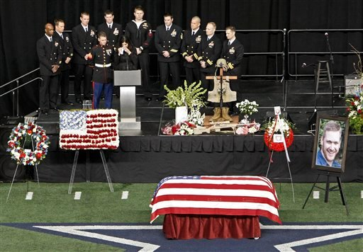© Christopher Kyle's wife, Taya, wipes tears away while memorializing her husband during a memorial service at Cowboys Stadium, Monday, Feb. 11, 2013, in Arlington, Texas.