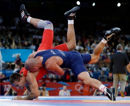 © In this Monday, Aug. 6, 2012 file photo Amer Hrustanovic of Austria competes against Damian Janikowski of Poland, in blue, during the 84-kg Greco-Roman wrestling competition at the 2012 Summer Olympics, in London.