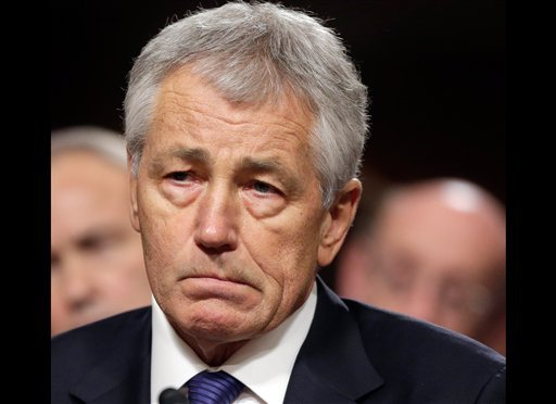 © In this Jan. 31, 2103 file photo, former Nebraska Republican Sen. Chuck Hagel, President Obama's choice for defense secretary, testifies before the Senate Armed Services Committee during his confirmation hearing on Capitol Hill in Washington.