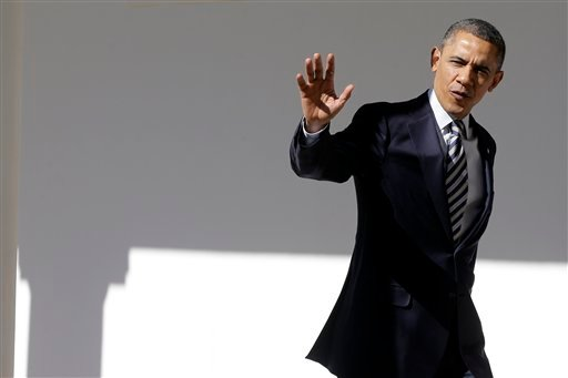President Barack Obama waves as he walks down the West Wing Colonnade of the White House in Washington, Tuesday, Feb. 12, 2013, ahead of tonight's State of the Union speech on Capitol Hill. (AP Photo/Charles Dharapak)