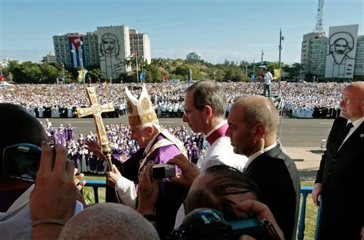 March 28, 2012 file: Pope Benedict XVI waves to faithful as he arrives to lead a Mass at Revolution Square in Havana, Cuba. On Feb. 11, 2013 the Vatican announced that Pope Benedict XVI will resign on Feb. 28, 2013. (AP Photo/Gregorio Borgia, file)