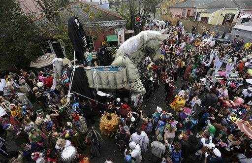 A trojan horse float makes its way through the crowd for the start of the Society of Saint Anne walking parade in the Bywater section of New Orleans during Mardi Gras day Feb. 12, 2013. (AP Photo/Gerald Herbert)