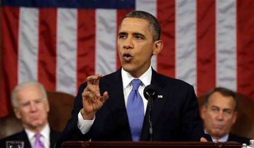 President Obama, flanked by Vice President Joe Biden and House Speaker John Boehner of Ohio, gestures as he gives his State of the Union address during a joint session of Congress on Capitol Hill Feb. 12, 2013. (AP Photo/Charles Dharapak, Pool)