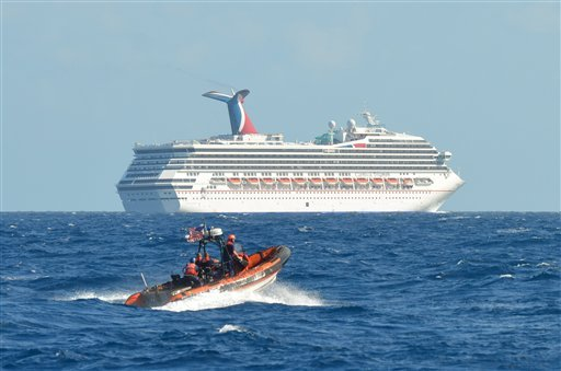 In this image released by the U.S. Coast Guard on Feb. 11, 2013, a small boat belonging to the Coast Guard Cutter Vigorous patrols near the cruise ship Carnival Triumph in the Gulf of Mexico, Feb. 11, 2013.