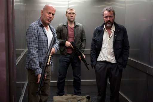 This film image released by 20th Century Fox shows Bruce Willis as John McClane, left, Jai Courtney as his son Jack, center and Sebastian Koch as Komarov in a scene from &quot;A Good Day to Die Hard.&quot; (AP Photo/20th Century Fox, Frank Masi)