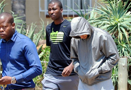 Olympic athlete Oscar Pistorius leaves the Boschkop police station, east of Pretoria, South Africa, Feb. 14, 2013 en route to appear in court charged with murder. (AP Photo/Chris Collingridge)