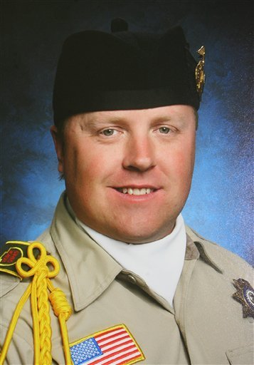 © This photo provided by the San Bernardino sheriff's department shows slain San Bernardino Sheriff Deputy Jeremiah MacKay.