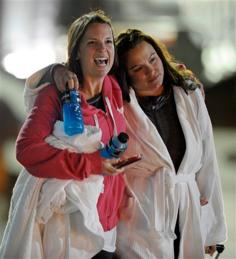 © Kristina Courson, left, of Paris, Texas, is embraced by Jamie Hilliard, of Denison, Texas, after getting off the cruise ship Carnival Triumph in Mobile, Ala., Thursday, Feb. 14, 2013.