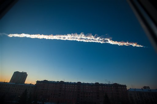 © In this photo provided by Chelyabinsk.ru a meteorite contrail is seen over Chelyabinsk on Friday, Feb. 15, 2013.