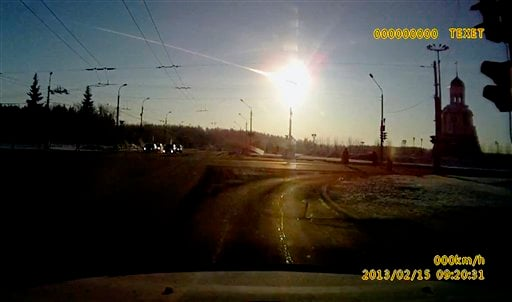 © In this frame grab made from a video done with a dashboard camera a meteor streaks through the sky over Chelyabinsk, about 1500 kilometers (930 miles) east of Moscow, Friday, Feb. 15, 2013.