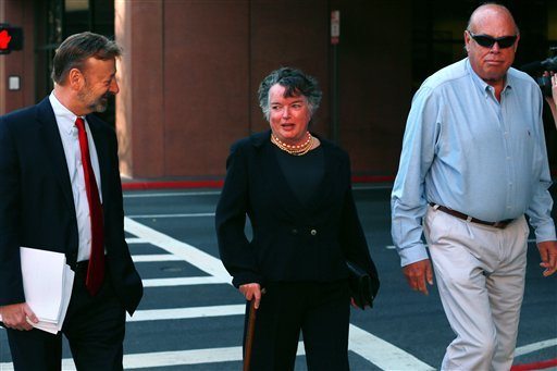 © Former San Diego mayor Maureen O'Connor, center, walks to federal court in San Diego Thursday, Feb. 14, 2013, with her attorney Eugene Iredale, left.