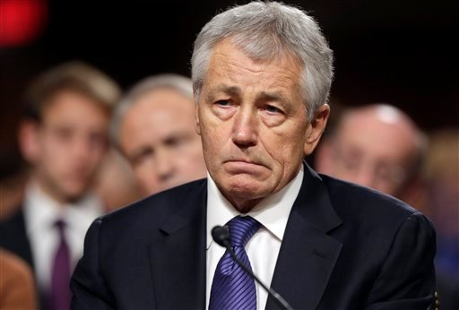 © In this Jan. 31, 2013, file photo, Republican Chuck Hagel, President Obama's choice for Defense Secretary, testifies before the Senate Armed Services Committee during his confirmation hearing on Capitol Hill in Washington.