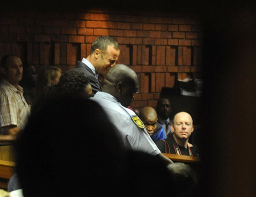 South African athlete Oscar Pistorius reacts, in court in Pretoria, South Africa, Friday, Feb 15, 2013, at his bail hearing in the murder case of his girlfriend Reeva Steenkamp.