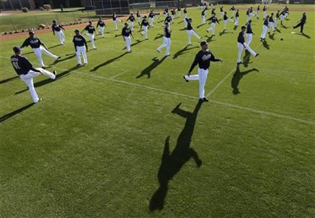 Players for the San Diego Padres stretch during a spring training baseball workout on Friday, Feb. 15, 2013, in Peoria, Ariz.
