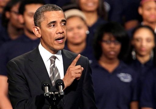 © President Barack Obama speaks about strengthening the economy for the middle class and the nations struggle with gun violence at an appearance at Hyde Park Academy, Friday, Feb. 15, 2013, in Chicago. (AP Photo/M. Spencer Green)