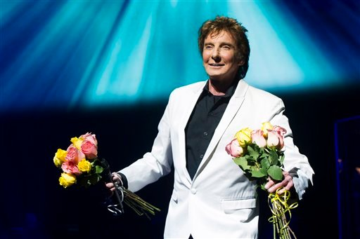 "© This Jan. 29, 2013 file photo shows Barry Manilow at the opening night curtain call for""Manilow on Broadway"" in New York."