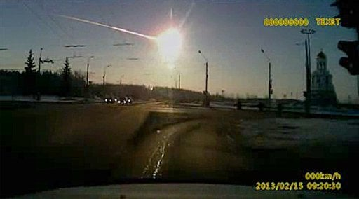 © In this frame grab made from dashboard camera video, a meteor streaks through the sky over Chelyabinsk, about 1500 kilometers (930 miles) east of Moscow, Friday, Feb. 15, 2013.