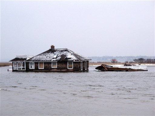 © This Feb. 5, 2013, photo,shows a home in the middle of Barnegat Bay, that was washed into the Bay from Mantoloking N.J. during Superstorm Sandy.