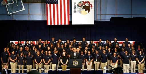 © In this photo taken Friday, Feb. 15, 2013, in Chicago, President Barack Obama speaks about the nations struggle with gun violence at an appearance at Hyde Park Academy.