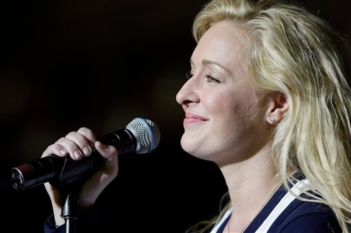 In this undated file photo, country singer Mindy McCready performs in Nashville, Tenn. McCready, who hit the top of the country charts before personal problems sidetracked her career, died Sunday, Feb. 17, 2013. She was 37. (AP Photo/Mark Humphrey, File)