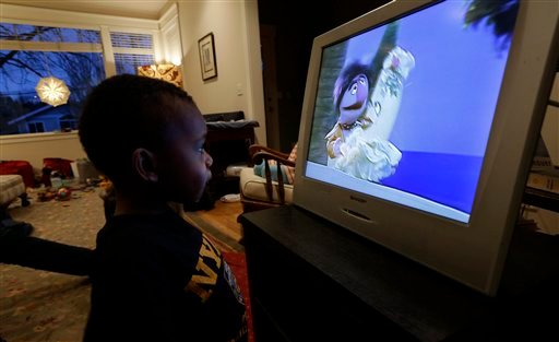 © Joe Jensen, 2, watches television as a special treat in the afternoon, Tuesday, Feb. 12, 2013 at his home in Seattle.