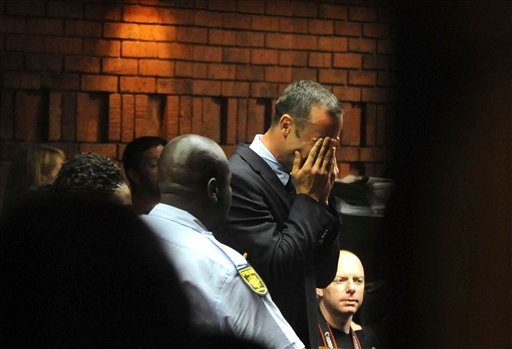 © Athlete Oscar Pistorius weeps in court in Pretoria, South Africa, Friday, Feb 15, 2013, at his bail hearing in the murder case of his girlfriend Reeva Steenkamp.