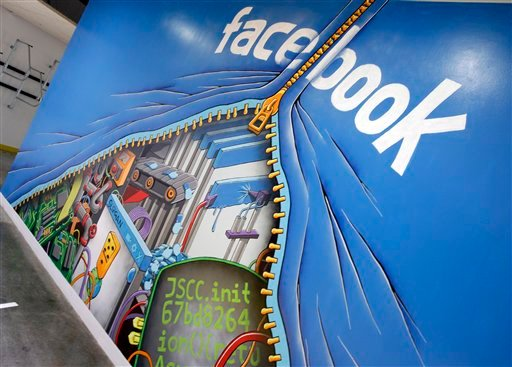 © This Feb. 8, 2012 photo shows a mural at Facebook headquarters in Menlo Park, Calif.